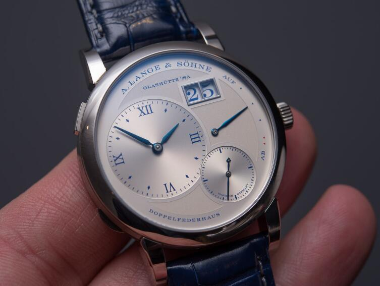 Swiss knock-off watches online are indicated with blue Roman numerals and blue hands.